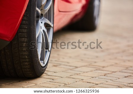 Kiev, Ukraine - OCTOBER 4, 2016: Mercedes Benz star experience. The interesting series of test drives. Close-up image of car wheel with black rubber tire #1266325936