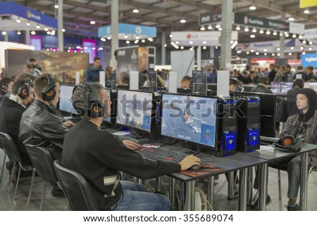 KIEV, UKRAINE - OCTOBER 11, 2015: People visit Wargaming company computer game zone during CEE 2015, the largest electronics trade show of Ukraine in ExpoPlaza Exhibition Center.