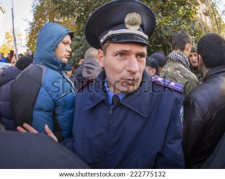 KIEV , UKRAINE - October 10, 2014: Police officers try to calm the activists before the passage of the Presidential Administration