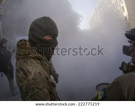 KIEV , UKRAINE - October 10, 2014: Smog then extinguish tire before the passage of the Presidential Administration on the action Avtomaydan