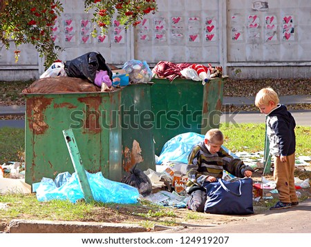 KIEV, UKRAINE - OCTOBER 6: Unidentified homeless children at a  dump on October 6, 2009 in Kiev, Ukraine. According to official  statistics, approximately 50,000 street children live in Ukraine