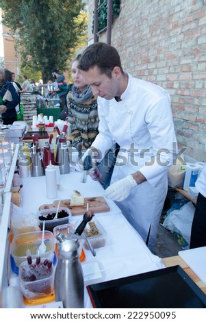 KIEV, UKRAINE - OCTOBER 11, 2014: Unidentified people cook and trades creative dishes of molecular cuisine on food stall in Street Food Festival in Kiev, Ukraine.