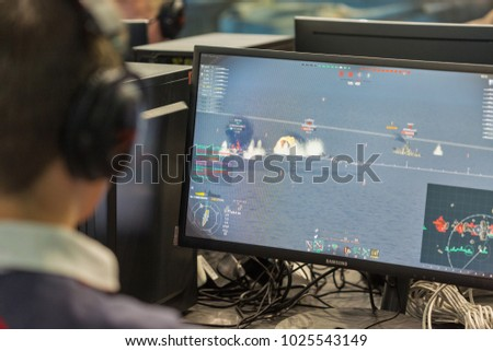 KIEV, UKRAINE - OCTOBER 08, 2017: Unrecognized people visit Wargaming company computer game zone during CEE 2017, the largest consumer electronics trade show of Ukraine in KyivExpoPlaza EC. #1025543149