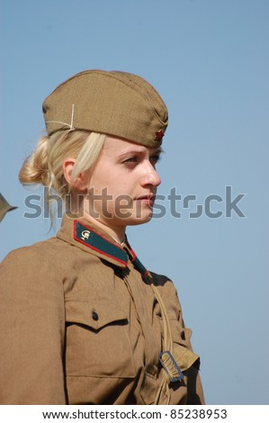 KIEV, UKRAINE -SEPT 18 : A member of Red Star history club wears historical Soviet uniform during historical reenactment of WWII, September 18, 2011 in Kiev, Ukraine
