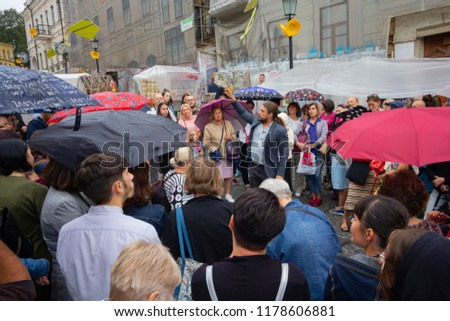 Kiev, Ukraine - September 09, 2018: Guide conducts excursions in the Andreevsky Descent - the historical part of the city