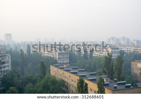 KIEV, UKRAINE �¢?? SEPTEMBER 3: Kiev Lisovoy district is in smoke from burning forest near Brovary. This morning would be sunny without this smoke.  #312688601