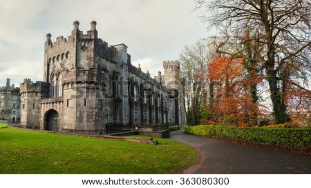 Kilkenny Castle and gardens in autumn with heavy clouds. It is one of the most visited tourist sites in Ireland