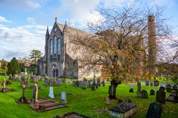 Kilkenny, Ireland. Cemetery in front of Cathedral Church of St Canices in Kilkenny, Ireland during the cloudy day