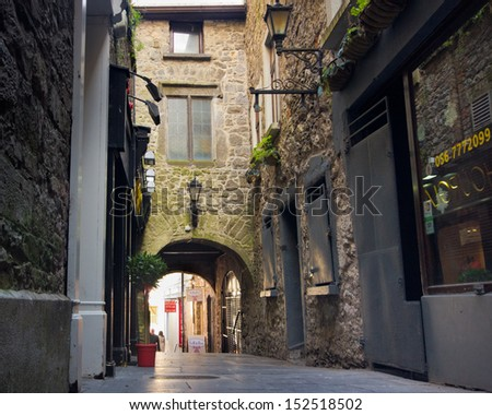 KILKENNY, IRELAND - MAR 28: Historic Butter Slip passageway in Medieval Kilkenny, Ireland on Mar 28, 2013. This narrow arched alley was built in the 1600's and was once lined with butter stalls. - stock photo