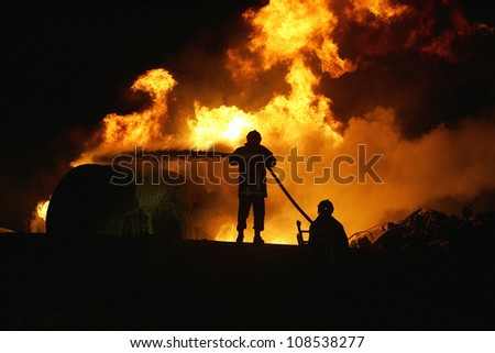 KILKIS, GREECE - MAY 9: Fire-fighters train at extinguishing a fire on May 9, 2007 in Aspros Kilkis, Greece.