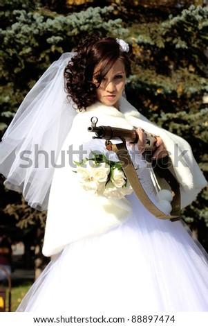 Killer bride take aim with a big rifle