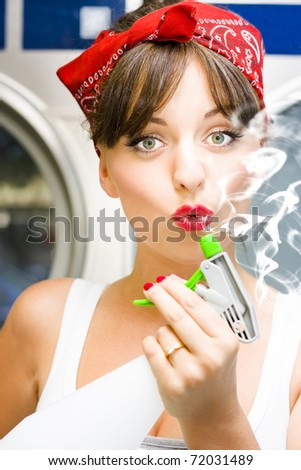 Killer Cleaning Lady Kills Germs In Style While Puffing On The End Of A Smoking Spray Bottle In A Funny And Humorous House Clean Concept