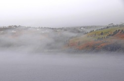 Killick Coast near Torbay,heavy fog over the ocean along the shoreline; Avalon Peninsula Newfoundland Canada