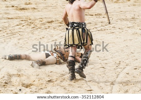 Killing, gladiator fighting in the arena of Roman circus