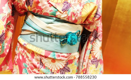 Kimono Japanese dress / The traditional dress of Japan is the kimono. Kimonos, which are generally made of silk, have large sleeves and reach from the shoulders all the way down to the heels.  - Shutterstock ID 788558230