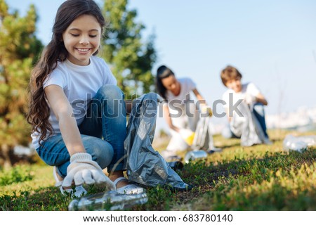 Kind children doing school tasks