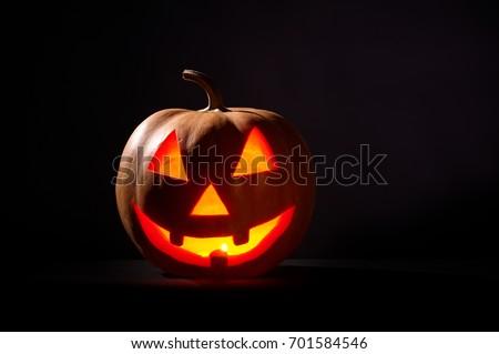 Kind Halloween Pumpkin On A Black Background #701584546