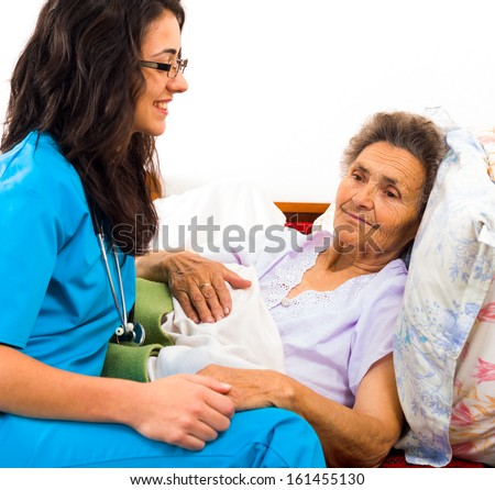 Kind Nurse Easing Elderly Lady\'S Days In Nursing Home With Care Help And Joy.