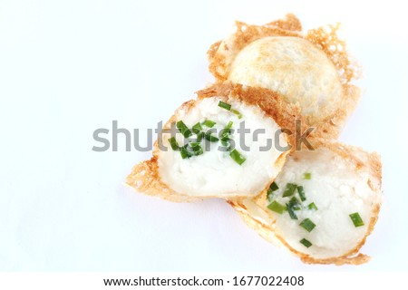 kind of Thai sweetmeat on white background. Kanom Krok, Thai traditional dessert. Coconut milk mix with powder fried dessert. Local Thai food Zdjęcia stock ©