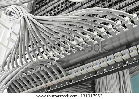 kind of wiring closet patch panels with 6-th category in the background