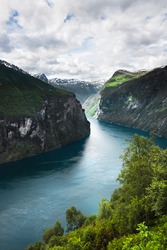 Kind on a fjord from above, Norway