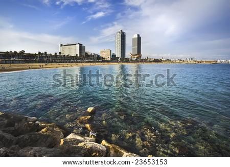 Kind on a sea beach from a pier, Barcelona, Spain