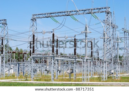 Kind on substation of a high voltage against the blue sky