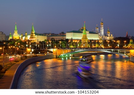 Kind to the Moscow Kremlin  and   Moskva River in dusk. Russia