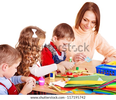 Kindergarden teacher with group children. Isolated .