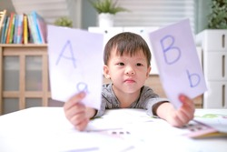 Kindergarten boy playing with flash cards , Asian children learning English with flash cards, Teach young kids English at home, Child at home, kindergarten closed during the Covid-19 health crisis