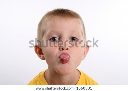 kindergarten boy sticking out his tongue