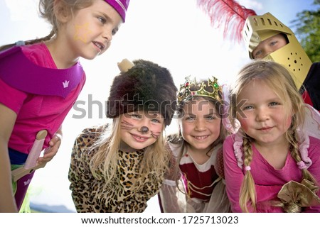 Kindergarten children in costume playing in a wood kindergarten