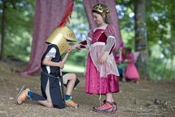 Kindergarten children in costume staging a play in a wood kindergarten