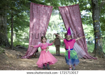 Kindergarten children in costume staging a play in a wood kindergarten