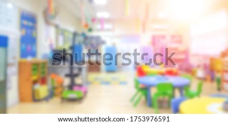 Kindergarten classroom school background. Class room for children students or nursery kids. Blur daycare preschool.