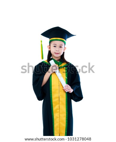 774007ebdd Kindergarten graduation. Happy asian child in graduation gown and cap  holding diploma certificate at studio