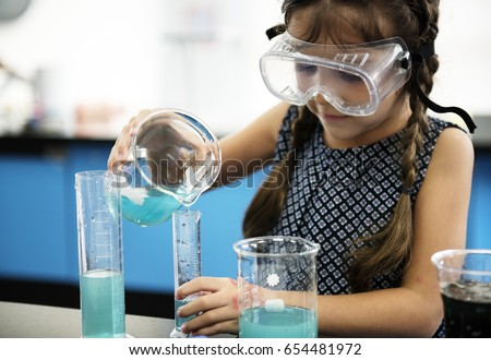 Kindergarten Student Mixing Solution in Science Experiment Laboratory Class