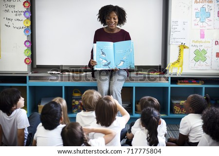 kindergarten students sitting...