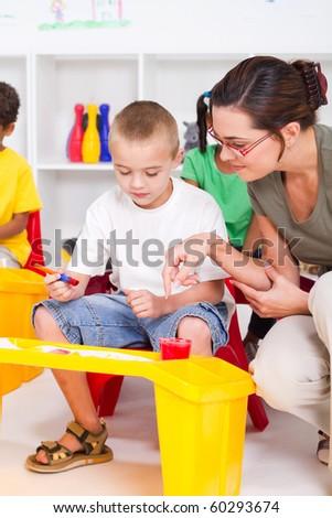 kindergarten teacher and preschool students