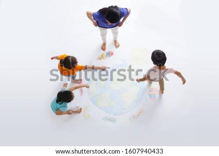 Kindergarten teacher with the children to draw Stock photo ©