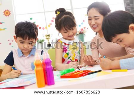 Kindergarten teachers and the children Stock photo ©