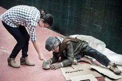 Kindness woman donates money to homeless beggar old man who is very hungry