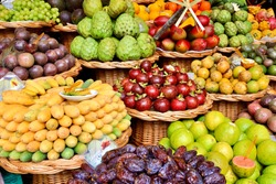 Kinds of tropical fruits displayed on stall of the Funchal market, Madeira, Portugal