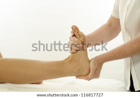 Kinesiologist or physiotherapist treating foot tibialis