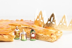 King cake or galette des rois in French. Traditional epiphany pie with golden paper crown and tiny charms