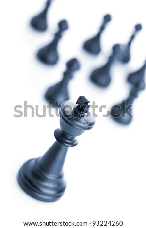 King chess figure in front of team over white background