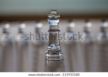 King chess piece, pawns behind, business concept series: - strategy, CEO, leadership, strength, business mentor, coaching, guru, success. Text / copy space, business card design.