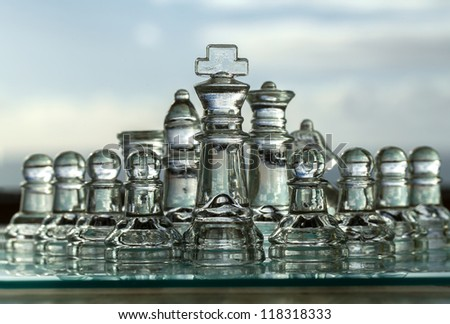 King & chess pieces - business concept series - strategy, team, challenge, corporation, company, competition, strength, leadership, success.