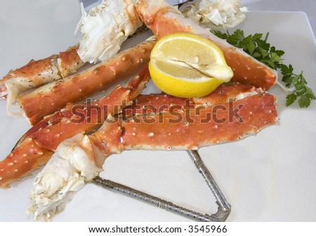 king crab legs and lemon with nutcracker