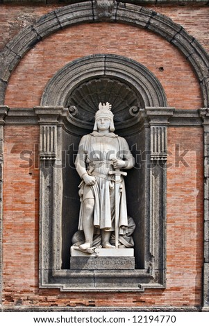 King Frederick II statue on facade of the Palazzo Reale (Royal Palace), Naples, Italy